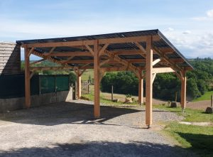 PHOTOVOLTAIC WOODEN CARPORT ON TECHNO METAL POST FOUNDATION